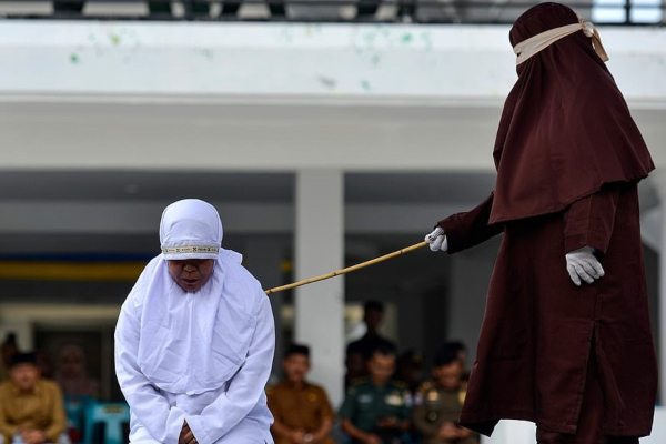 An Indonesian Woman Disgracefully Flogged In Public For Having S*x Outside Marriage (Photos)
