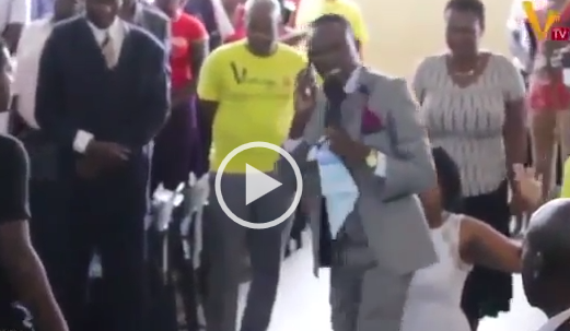 Zimbabwean Pastor calls God directly on phone during church service – (See video)