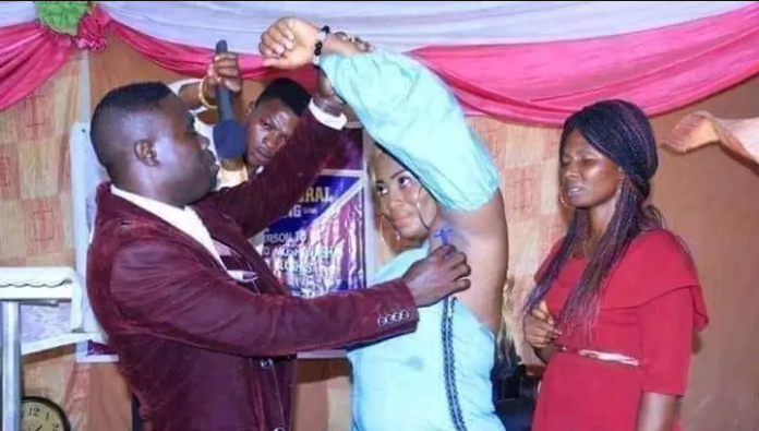 Pics: Pastor Shaves The Armpit Of A Female Member In Church (Christians React)